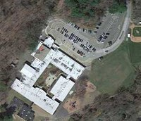 Police: Conn. shooter forced way into school