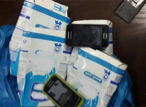 Qibbeh prison guards find phones hidden inside milk cartons. (Photo Internal Security Forces' Twitter page)