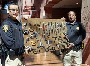 Clark County Deputy Marshals Mike Petty. left, and Ronald Ramsey show off a display of confiscated weapons and prohibited items at the Regional Justice Center Thursday, September 19, 2013. (Image Steve Marcus/The Las Vegas Sun)
