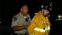 Firefighter handcuffed by officer at freeway crash files claim