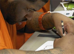Anthony Pratt, an inmate at San Francisco's County Jail No. 5, sketches out a design for an alternative kind of space for the criminal justice system. (Photo Lee Romney, Los Angeles Times)