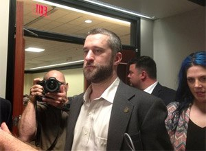 Television actor Dustin Diamond, center, leaves court in Port Washington, Wisc., after being convicted of two misdemeanors stemming from a barroom fight on Christmas Day 2014.
