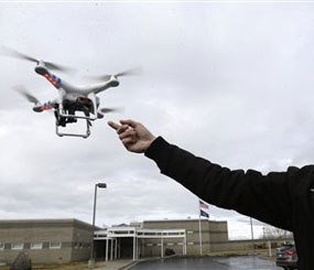 In this Feb. 13, 2014, photo, Jon McBride, who designs and builds drones with Digital Defense Surveillance, flies a training drone for members of the the Box Elder County Sheriff's Office search and rescue team, during a demonstration, in Brigham City, Utah.