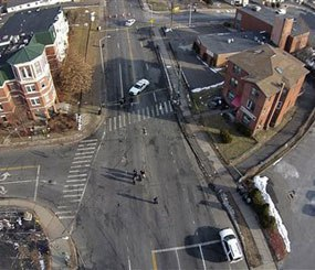 This Feb. 1, 2014 photo, taken by a camera mounted on a drone aircraft and provided by Pedro Rivera, shows an auto that crashed into a building in Hartford, Conn.