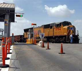 In this Monday, July 20, 2009 photo, a Missouri-Pacific train is shown stopped near the U.S. Mexico Border in Brownsville,Texas. (AP Photo/Brad Doherty)