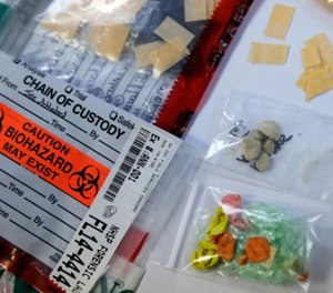 In this Tuesday, Feb. 21, 2017 photo, a selection of confiscated contraband drugs, which were found after smuggling attempts, are displayed at the New Hampshire State Prison in Concord, N.H. (AP Photo/Charles Krupa)