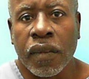 Larry Mark (pictured) was serving a life sentence for murder when he was killed by his cellmate Thursday.