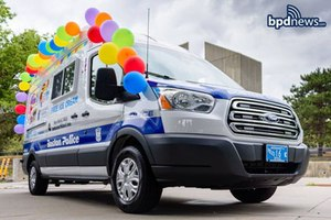 In this photo, the Boston Police Department's newest vehicle, adorned with balloons and Boston police decals, is shown.