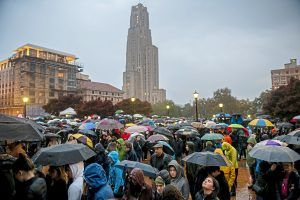 Mourners, most of whom stood in the rain because of over crowdedness, attend a vigil for the victims of the Tree of Life Synagogue mass shooting at Soldiers and Sailors Memorial Hall and Museum on Sunday, Oct. 28, 2018, in Pittsburgh. (Michael M. Santiago/Pittsburgh Post-Gazette via AP)