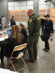 Tactical Dispatcher Rebecca Williams, Sacramento County Sheriff's Department and Tactical Dispatcher Melyssa Gowen, Butte County Sheriff's Department, assist the BCSO detective division in managing and organizing missing persons reports.