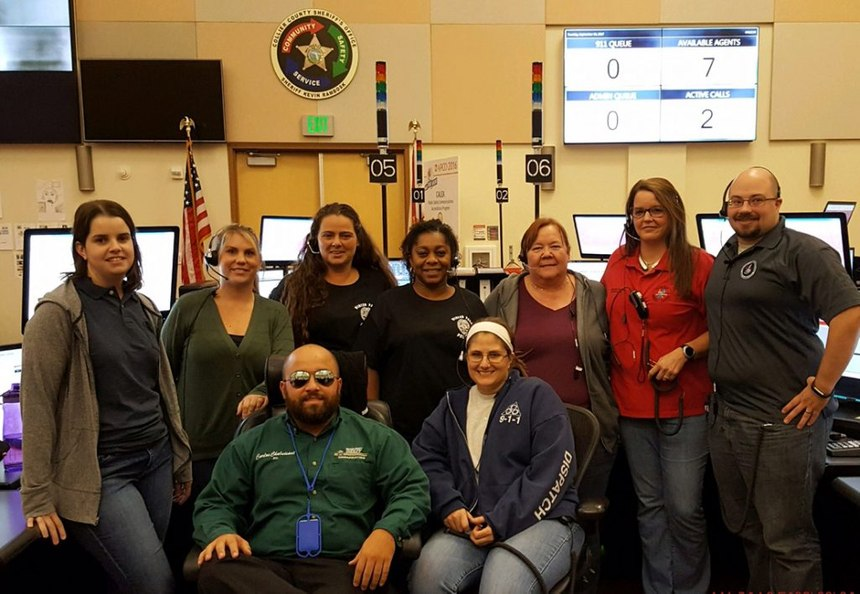 Georgia TERT dispatchers Tabitha Carver (Fulton County, GA) and Aaron Schwab (Cherokee County, GA), at right, with personnel from the Collier County, FL 911 Center during the TERT response after Hurricane Irma.