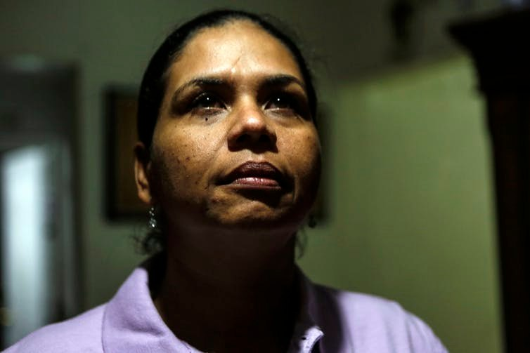 After being stabbed nearly to death, Wanda Gomez was advised by authorities in her Florida community to quit her job and leave her home. She lost her ability to make a living and provide a safe living environment for her family. Image: AP/Ellis Rua
