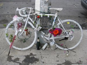 Cycling advocates set up 'ghost bikes,' like this one in Brooklyn, in memory of bikers killed in traffic.