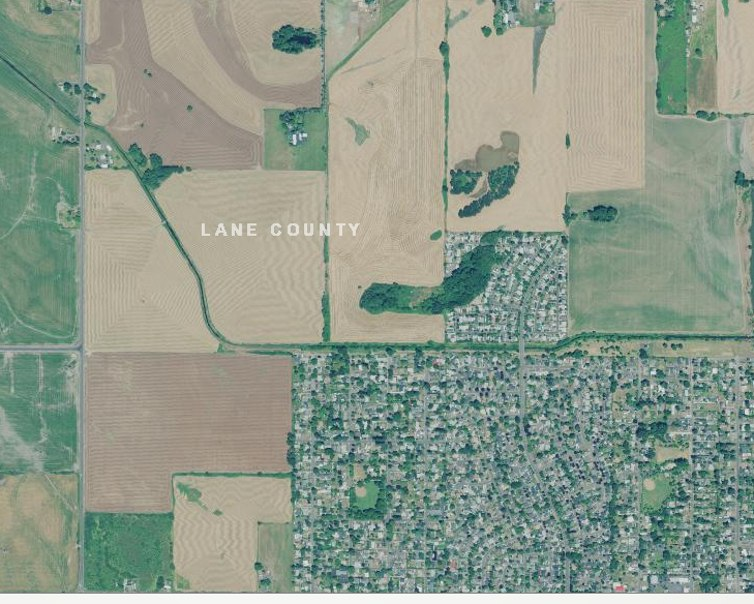 Eugene, Oregon's urban growth boundary has protected land just outside city limits from development, but single-family residential land constitutes 87% of residential land inside the boundary. Image:Oregon Imagery Explorer, http://imagery.oregonexplorer.info/