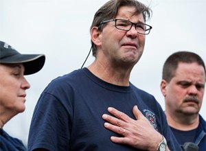 Darrington Fire District 24 volunteer firefighters, Jan McClelland, left, Jeff McClelland, center, and Eric Finzimer, first responders to the massive mudslide talk to the media about their experiences as rescue workers. (AP Photo/The Seattle Times, Marcus Yam)