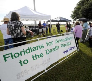 Protesters against the death penalty demonstrate in front of the Florida State Prison near Starke, Fla., Thursday, July 10, 2014. (AP Photo/Phil Sandlin)