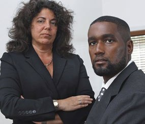 Albert Florence, right, sits at his home Bordentown, N.J., with his attorney Susan Chana Lask. In a 5-4 decision, the Supreme Court ruled against Florence, who faced strip searches in two county jails following his arrest on a warrant for an unpaid fine that he had, in reality, paid.