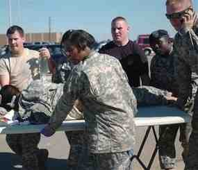 This Thursday, Nov. 5. 2009 photo released by the Defense Department shows first responders using a table as a stretcher to transport a wounded Soldier to an awaiting ambulance at Fort Hood, Texas. (AP Photo/Defense Department, Sgt. Jason R. Krawczyk)