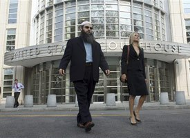Imam Ahmad Afzali, left, who pleaded guilty to lying to the FBI, leaves Brooklyn federal court after his sentencing, Thursday, April 15, 2010 in New York. (AP photo)