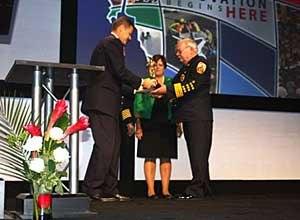 Photo Jamie ThompsonDeputy Chief John Carney recieves the award at FRIon behalf of Chief Robert Perry.