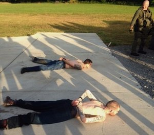 Two restrained fugitives. (Photo/Tennessee Bureau of Investigation via AP)