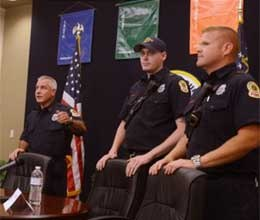 Photo AP Lawrenceville Firemedic Sydney Garner, right, talks about the hostage situation as five Gwinnett County firefighters talk about their experiences after being held hostage on April 10.