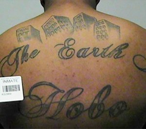 This undated file photo in a court filing provided by the United States Attorney's office in Chicago, shows a gang member's back tattoo that reads