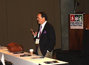 Photo Jamie ThompsonGist speaks about After Action Reviews to an audience at Fire-Rescue International.