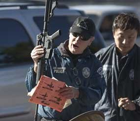 Los Angeles Police officials get an assault weapon back at the LA Memorial Sports Arena in Los Angeles Wednesday, Dec. 26, 2012. Los Angeles police are offering groceries for guns in a buyback program that was moved up in the wake of the Connecticut tragedy. (AP Image)