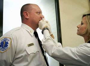 AP Photo/Rich SchultzJamie Chebra, a paramedic and EMS manager in Trenton, N.J.,receives the H1N1 vaccine Thursday.