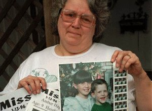 Glenda Whitson holds a picture of her granddaughter, Amber, 9, along with flyers advertising for the whereabouts of the missing child, Monday, Jan. 15, 1996, in Arlington, Texas. Amber was abducted two blocks from Whitson's home while riding her bicycle on Saturday.