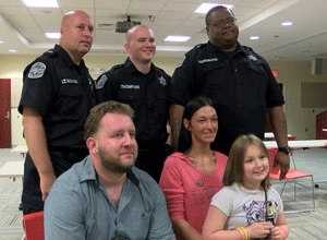 Amber Lloyd sits with her family and the three correctional officers who saved her life. (Photo ABC News)