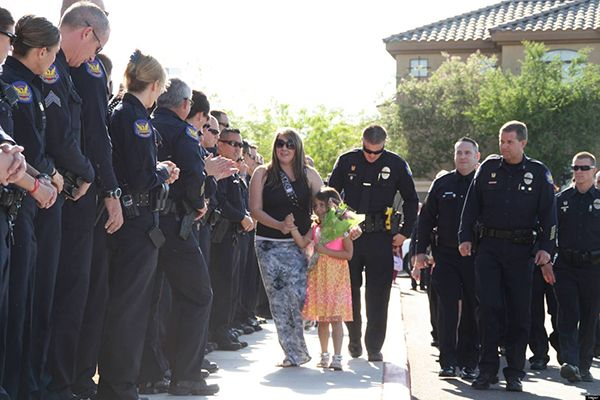pros and cons of being a police officer, officers show up for kindergarten graduation