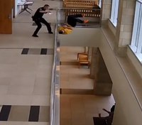 Video: Inmate runs out of courtroom, jumps off second-story balcony