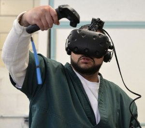 Leroy Gardenhire uses virtual reality inside the Fremont Correctional Facility in Cañon City to simulate doing laundry in a laundromat. (Meredith Turk/CPR News)