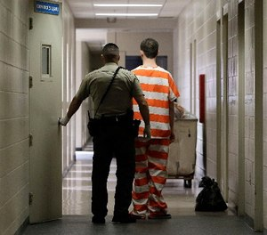 A true professional has the ability to employ many response tools at the same time when interacting with inmates. (AP Photo/Rich Pedroncelli, File)