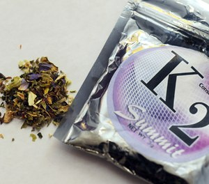 This Feb. 15, 2010, photo shows a package of K2 which contains herbs and spices sprayed with a synthetic compound chemically similar to THC, the psychoactive ingredient in marijuana.