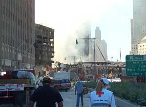 Image Kelly CloseThe author is seen at Ground Zero with two responders on September 12, 2001