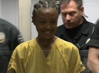 Smiling inmate accused of biting CO makes request of judge