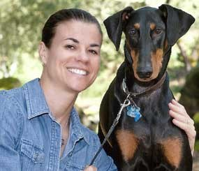Former Santa Rosa police officer Lucia Wade is pictured with her dog Cody at a November fundraiser for Memorial Hospital in Santa Rosa, her local trauma center. Two and a half years ago a car struck her during a foot pursuit, and the critical injuries sustained prevented her return to policing, which she described as her dream job.