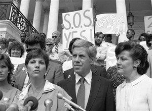 Candy Lightner, left, founder and president of (MADD) Mother Against Drunk Drivers, faces reporters, on June 14, 1983, at Capitol Hill, Washington. Lightner is joined by Sen. Richard Lugar, R-Ind., and Transportation Secretary Elizabeth Dole. The three favor a national drinking age of 21.