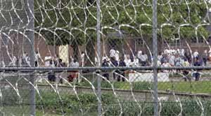 Inmates at the Lakeland Correctional Facility in Coldwater, Mich., mill about the yard on June 1, 2007. (AP photo)