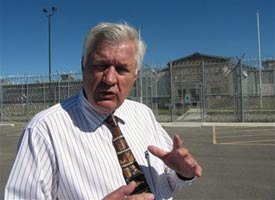 Albert Peterson with the Two Rivers Authority stands outside an empty jail that Hardin, Mont. built for $27 million. (AP Photo/Matthew Brown)