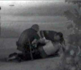 A still frame from security camera video captures Kelly Thomas' encounter with police.