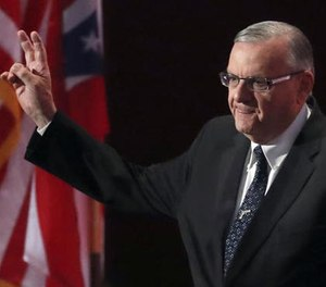 In this July 21, 2016, file photo, Sheriff Joe Arpaio of Arizona walks on the stage to speak during the final day of the Republican National Convention in Cleveland.