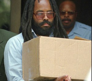 In this July 12, 1995, file photo, Mumia Abu-Jamal, a former Black Panther and radio reporter convicted of the 1981 murder of white Philadelphia police officer Daniel Faulkner, leaves after a hearing at City Hall in Philadelphia. (AP Photo/Chris Gardner, File)