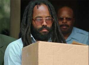 In this July 12, 1995 file photos, convicted police killer and death-row activist Mumia Abu-Jamal leaves Philadelphia's City Hall after a hearing. (AP Photo/Chris Gardner, File)