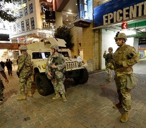 National Guardsman stand on the street in downtown Charlotte, N.C. on Thursday, Sept. 22, 2016. (AP Photo/Gerry Broome)