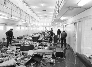 This Feb. 4, 1980 file photo shows guards at the New Mexico State Penitentiary cleaning up cell block six at the prison in Sante Fe, N.M. after a violent riot at the state's maximum-security penitentiary near Santa Fe. (AP Photo/Ed Andrieski, File)