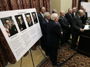 Retired FBI agent Jay Cochran, at podium, speaks during a news conference on the murder convictions of the Norfolk Four in Richmond, Va., Monday, Nov. 10, 2008. (AP Photo/Steve Helber)